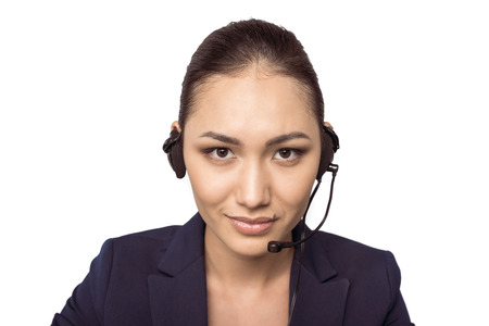 young asian call center operator in headset looking at camera