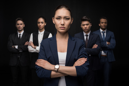 Group of professional business team standing with arms crossed