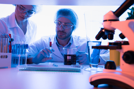 Scientists at chemical laboratory