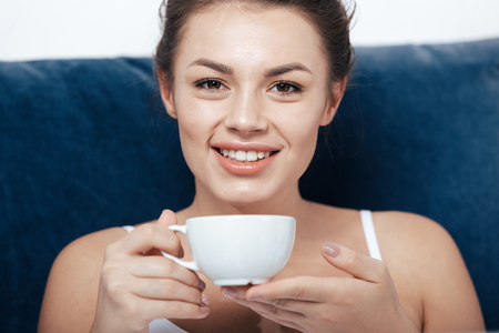 woman having morning coffee in bed