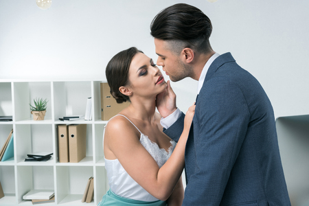 business colleagues able to kiss in modern office