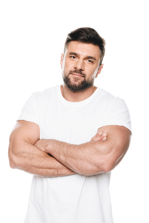 Portrait of confident bearded man posing with arms crossed and looking at camera Stock Photo