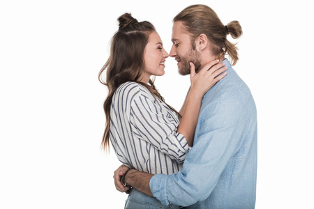 happy young couple able to kiss isolated on white Stock Photo