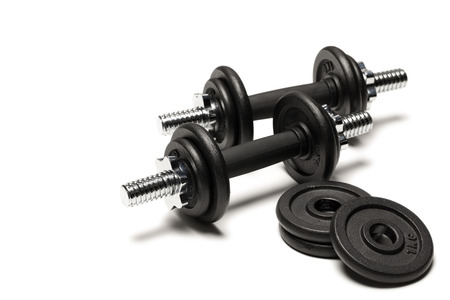 iron dumbbells with weight plates isolated on white