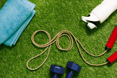 jump rope in form of word go with towel and bottle