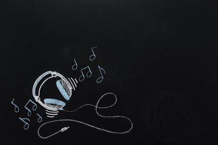 headphones with wire and musical notes drawn Stockfoto