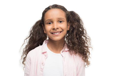 adorable little girl smiling at camera isolated on white