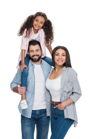Happy multiethnic family smiling at camera Stock Photo