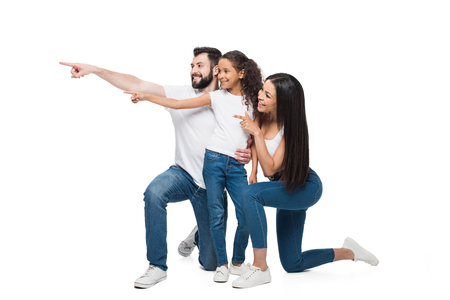 smiling multiethnic family together pointing away with fingers