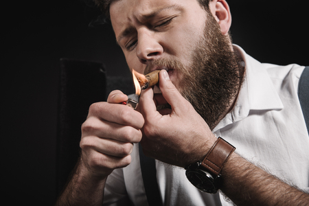 bearded man with watch smoking cigar Stock fotó - 83498815