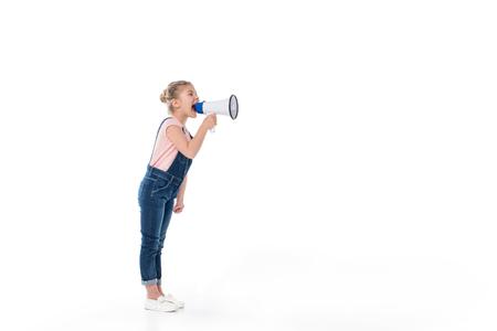 メガホンで叫んでいる愛らしい少女の完全な長さの表示 写真素材