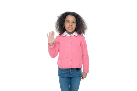 happy african american girl waving at camera, isolated on white Banco de Imagens