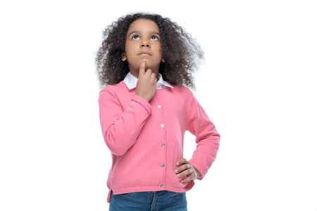 little thoughtful african american girl in pink cardigan