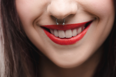 young girl with red lips and piercing in nose