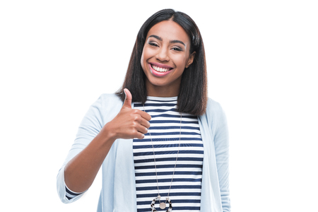 african american woman showing thumb up and smiling at camera Reklamní fotografie