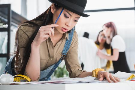 fashion designer working in clothing design studio Stock Photo
