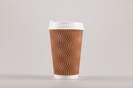 cardboard disposable coffee cup isolated on beige, coffee to go concept Stock Photo