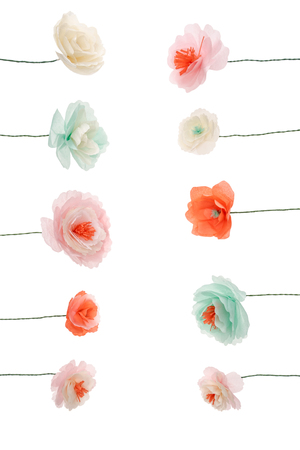 Decorative multicolored papercraft flowers arranged