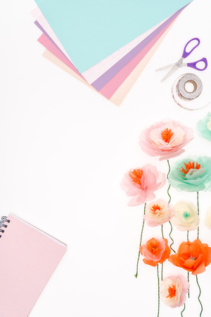 top view of decorative flowers and stationery items