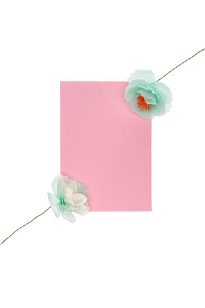 Decorative handmade flowers with blank card arranged