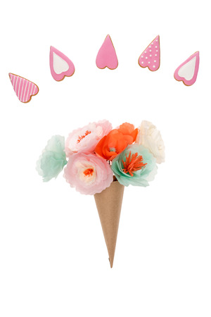 handmade flowers in paper cone and heart shaped cookies