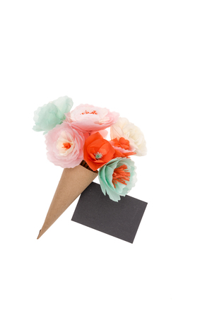 decorative handmade flowers and blank postcard