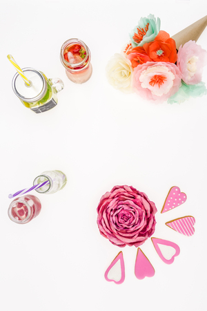 top view of refreshing lemonades, handmade flowers and cookies