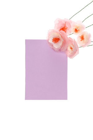 Close-up view of handmade flowers with blank card arranged