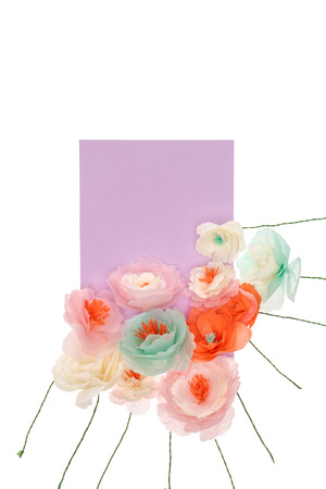 Close-up view of tender handmade flowers with blank card arranged