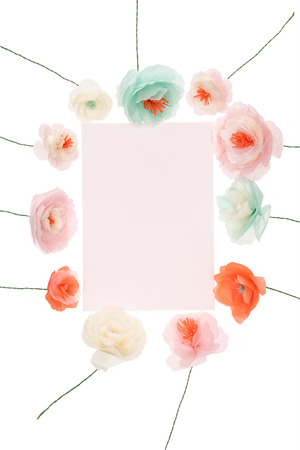 Beautiful handmade flowers arranged around blank greeting card Stock Photo