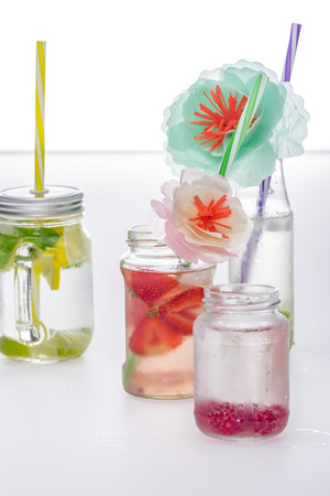 refreshing lemonades with straws and decorative flowers