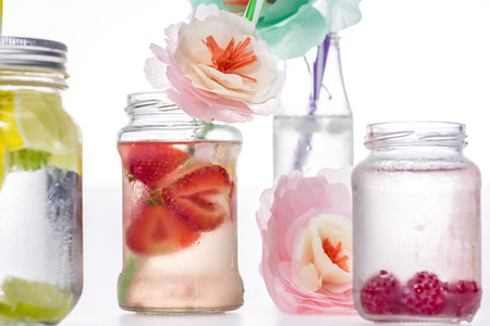 close up view of fresh berries drinks and decorative flowers