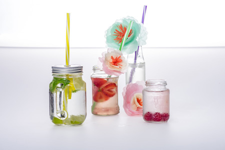 refreshing drinks with straws and handmade flowers Stock Photo