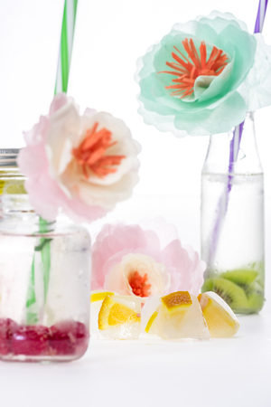 refreshing fruity drinks with decorative flowers and ice cubes
