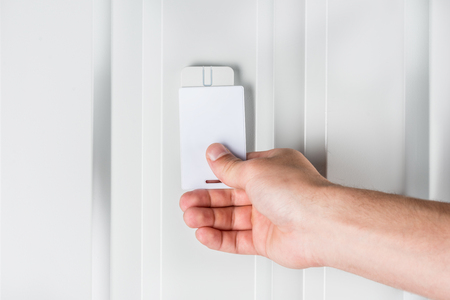 validation: person opening door with electronic card Stock Photo