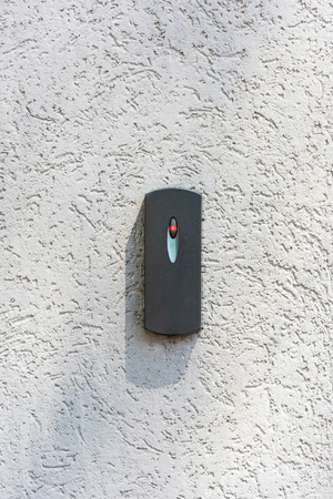 door access control on white concrete wall