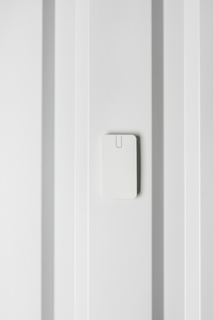 electronic door lock on white wall Stock Photo