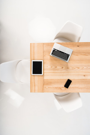 various digital devices with blank screen at workplace in office
