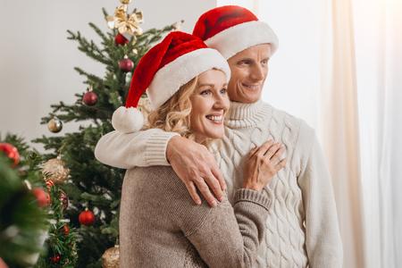 senior couple in santa hats Stock Photo