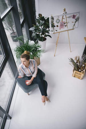 thoughtful attractive businesswoman on coffee break in modern office