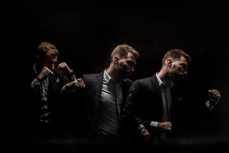 multiple exposure of businessman punching somebody