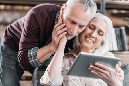 senior couple using tablet together at home