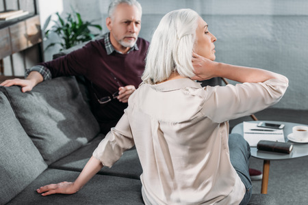 senior woman suffering from strong neck ache