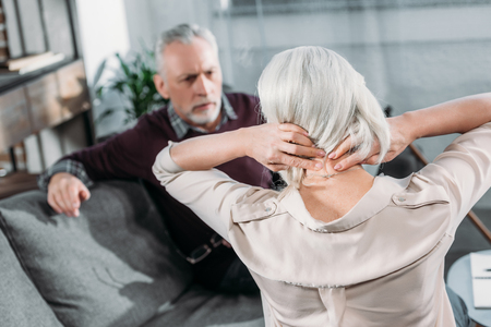 back ache: senior woman suffering from strong neck ache
