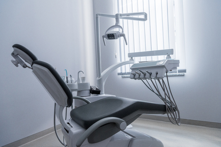 dentist office with chair and various dental equipment
