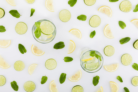 flat lay with refreshing lemonades, limes, lemons and mint leaves Stock Photo
