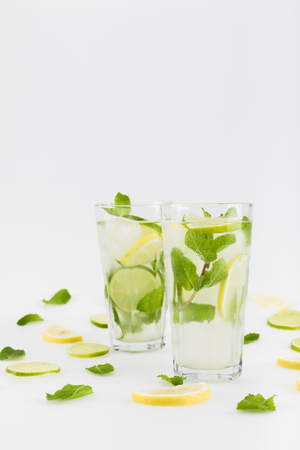 close up view of refreshing citrus lemonades with mint leaves