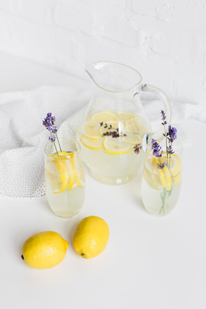 refreshing summertime beverages with lavender flowers in glasses and jar