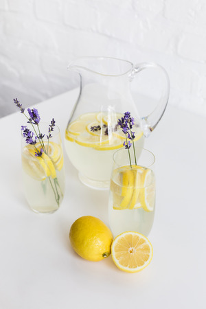 refreshing summertime lemonade with lavender flowers in glasses and jar Stock Photo