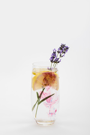 homemade lemonade with lavender and lemon pieces in glass